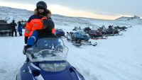 Kirst and Phil on a snowmobile in Iceland